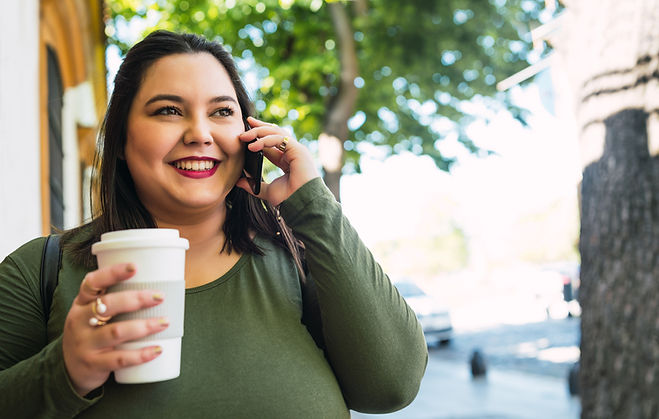 young-plus-size-woman-talking-on-the-pho