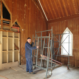 John prepping the interior of the church building for restoration