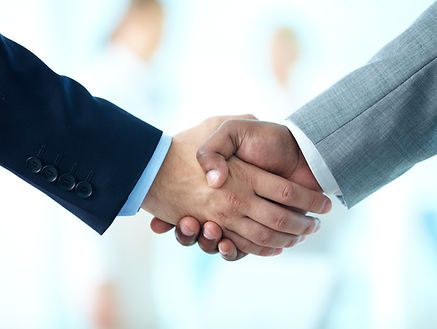 Close-up of business people shaking hand