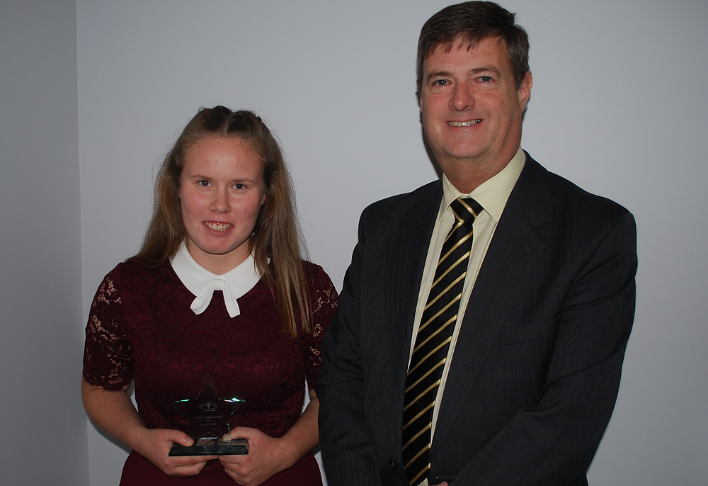 Milly Kyne receiving the Young Unsung Heroes Award for 2016