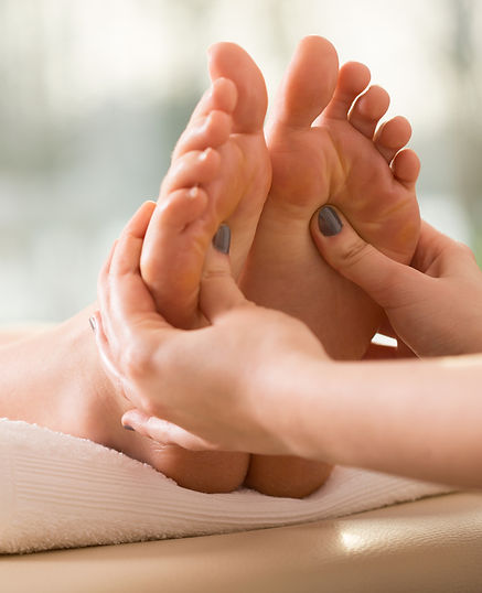 foot massage involving pressure points that help the body to unblock energy channels and self-heal