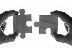 macro-shot-jigsaw-puzzles-teamwork-concept.jpg