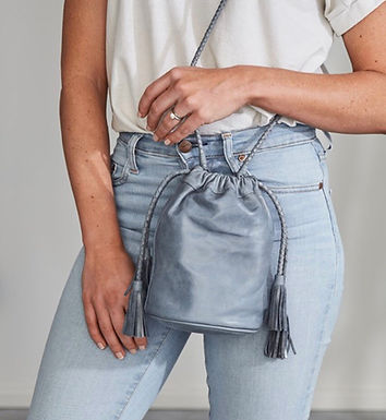 Ovae the Label, Scarlet Mini Leather Bucket Bag with Detail Tassels | Peacock