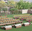 ceremony setup and aisle flowers - white - wood rental chairs - austin tx