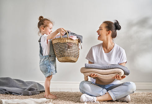 Beautiful young woman and child girl lit