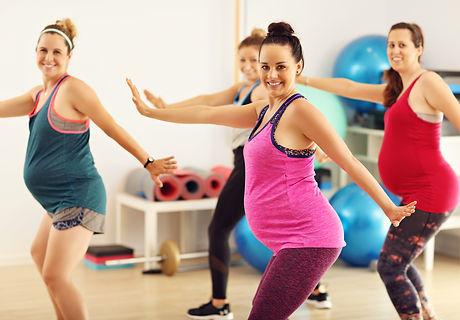 Group of pregnant women during fitness class.jpg