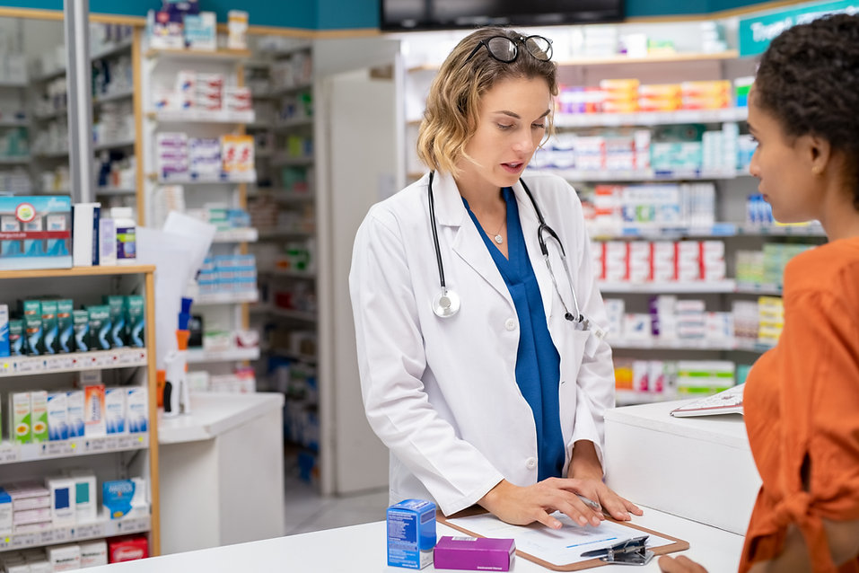 pharmacist-giving-medicine-with-prescrip