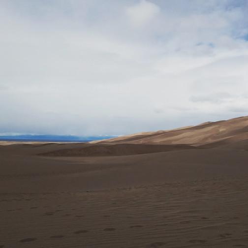 People sled the dunes, hence that guy's bright orange toboggan.
