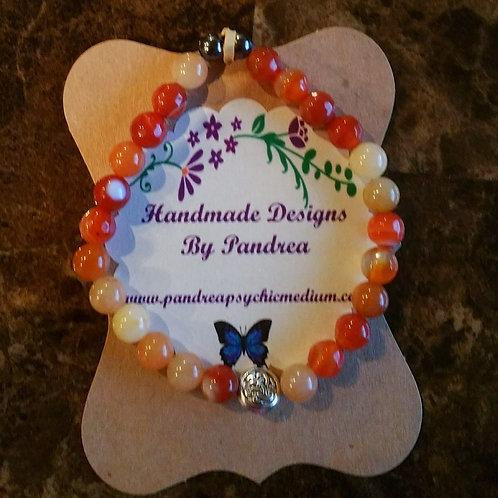 Multi-color Orange Jade Bracelet w/ celtic knot