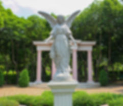 Guardian angel statue in sunlight as a s