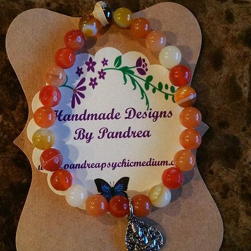 Multi-color Orange Jade Bracelet w/ Sitting Ganesh