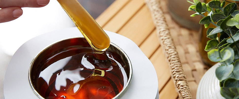 bowl of wax with waxing tool, brow waxing round rock, lip wax round rock, chin waxing round rock, waxing round rock tx
