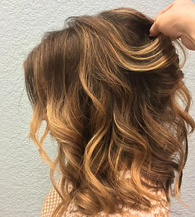 wavy brown hair with blonde highlights