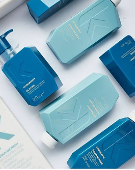 multiple hair products in blue bottles