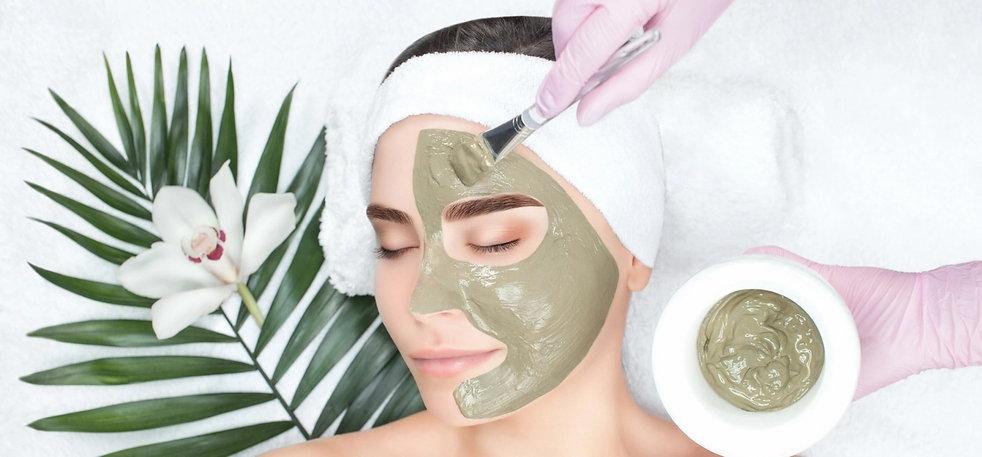 woman at salon receiving a facial mask treatment, facial treatments round rock, cleanse facial, glow facial, body waxing