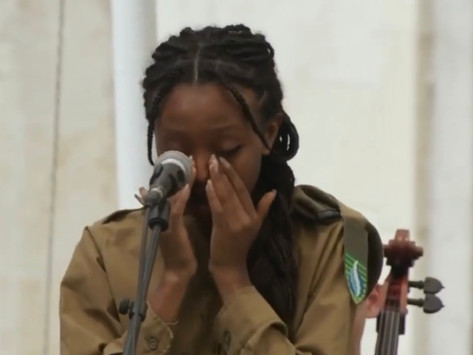 Watch as Israeli popstar Eden Alene can't hold back her tears while singing at