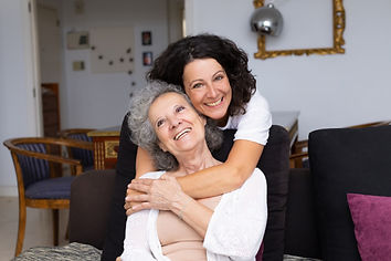 happy-middle-aged-woman-hugging-senior-l
