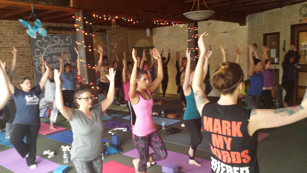 Yogis in tree pose at Marci's downtown