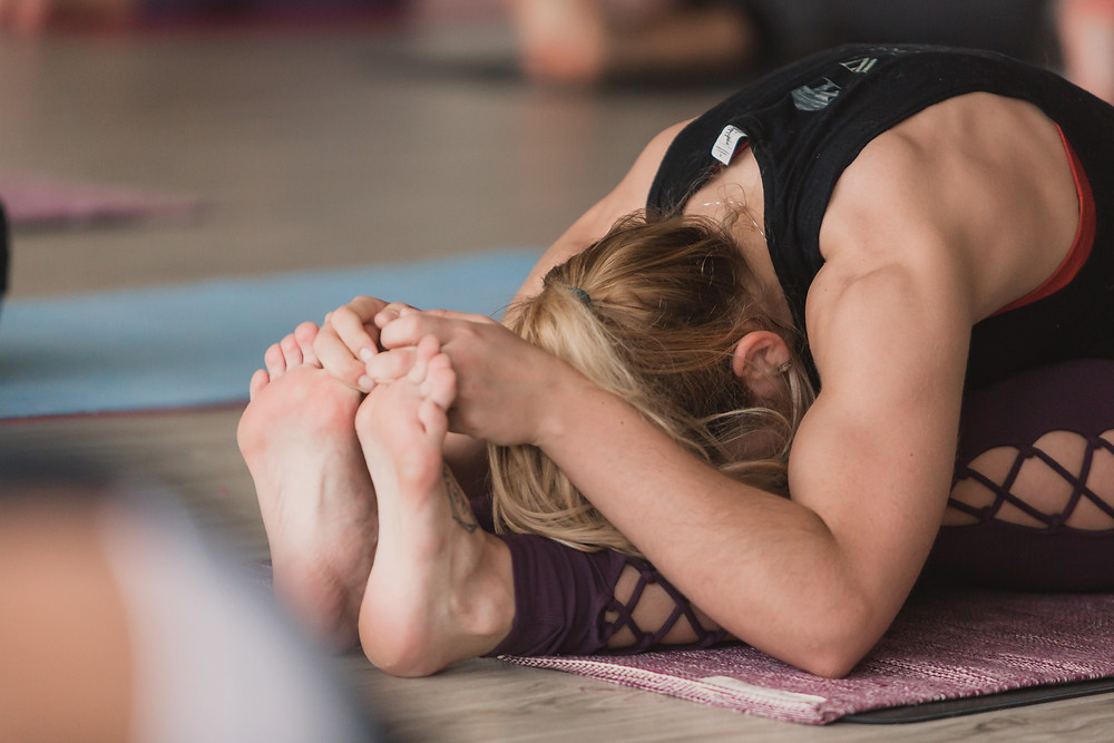 Hope Dalrymple in forward fold at Yogaja Yoga Toledo by Mary Wyar Photography