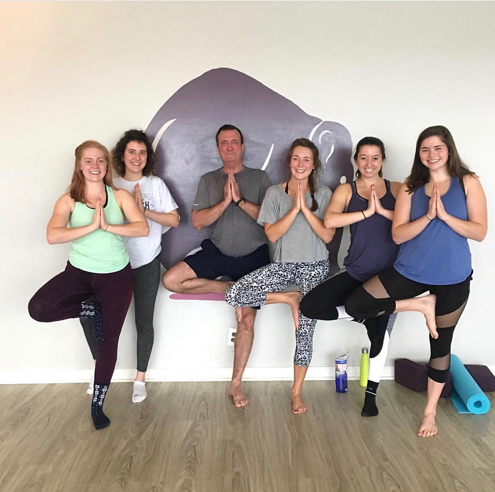 Jim Mihaly and his daughters and their friends at Yogaja Yoga Toledo