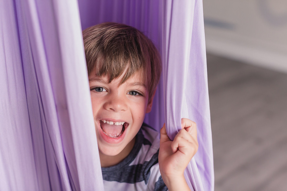 Young boy in aerial hammock at Yogaja Yoga Toledo by Mary Wyar Photography