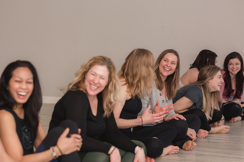 Yogaja Yoga teachers laughing by Mary Wyar Photography.