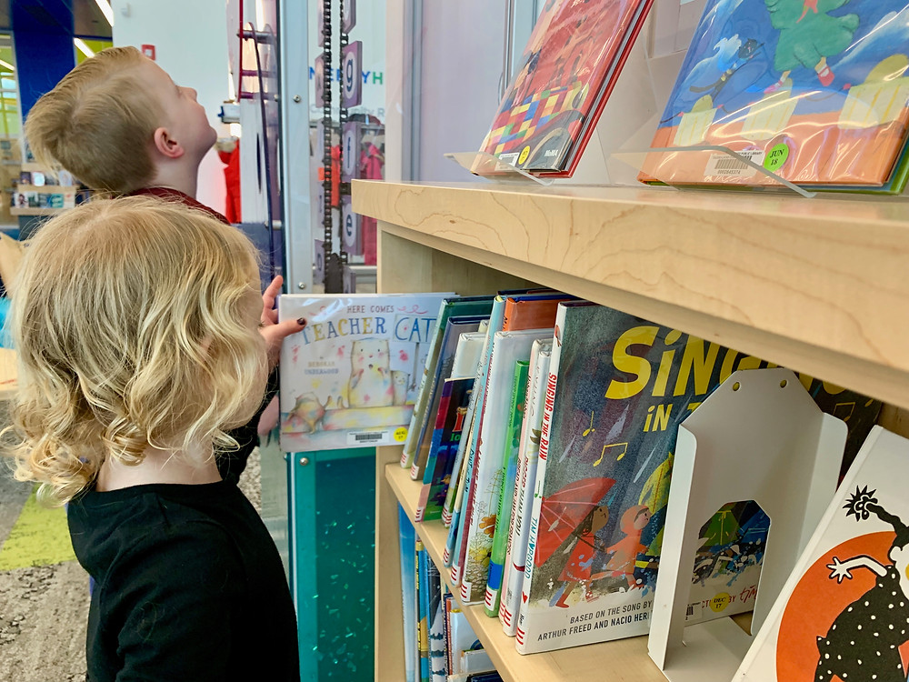 Two young children finding books at Sylvania Library