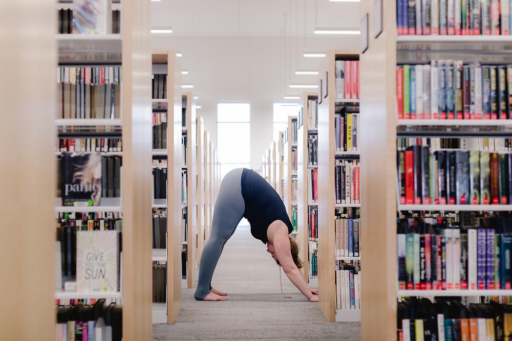 Erin Marsh in down dog at Sylvania Library