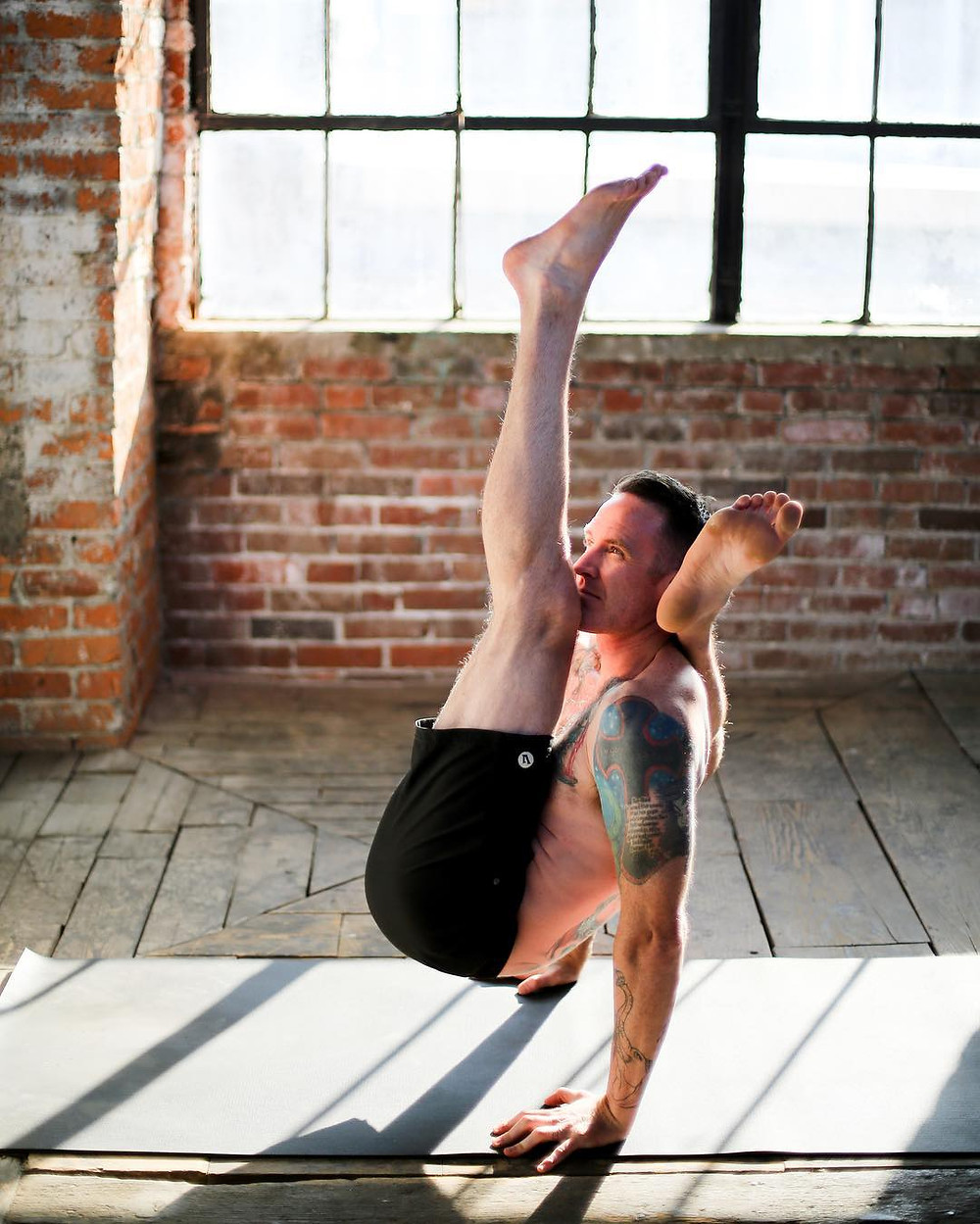 Taylor Hunt practicing advanced yoga pose from ashtanga
