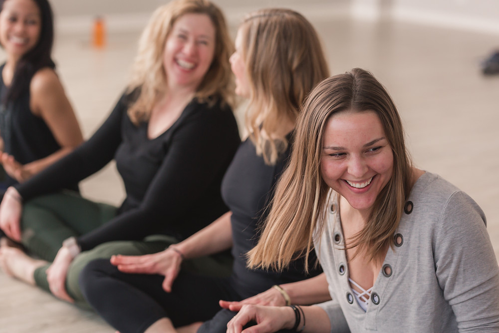 Yogaja teachers laughing together
