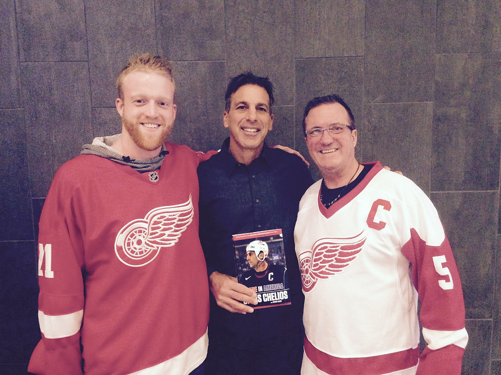 Jim Mihaly and his son Eric with Hall of Fame hockey player Chris Chelios