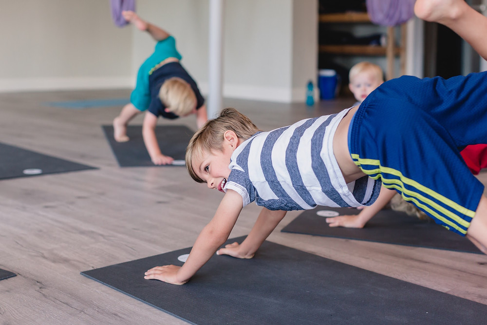 Kids in down dog at Yogaja Yoga Toledo by Mary Wyar Photography