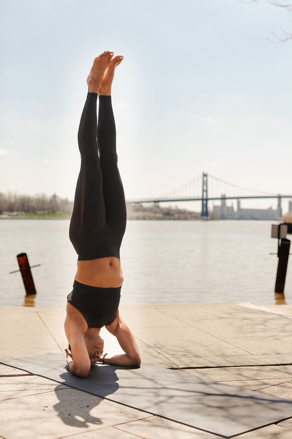 Diana Patton in headstand in downtown Toledo by Mary Wyar Photography