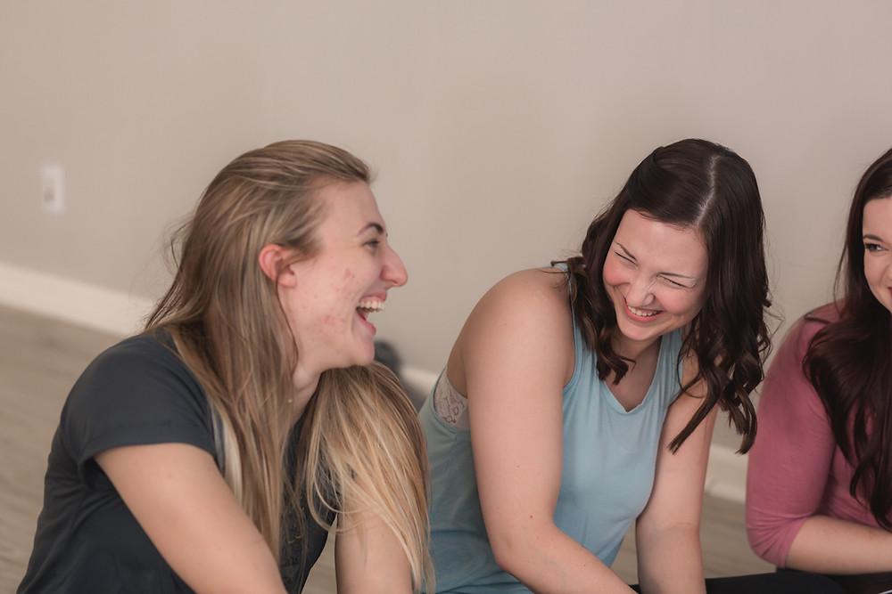 Brittany Wilkewitz and Lisa laughing at Yogaja Yoga Toledo Mary Wyar Photography