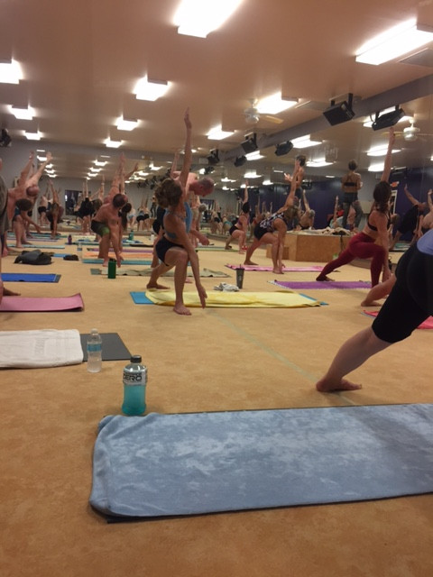 Yoga practioners in side angle pose at Hot Room Toledo