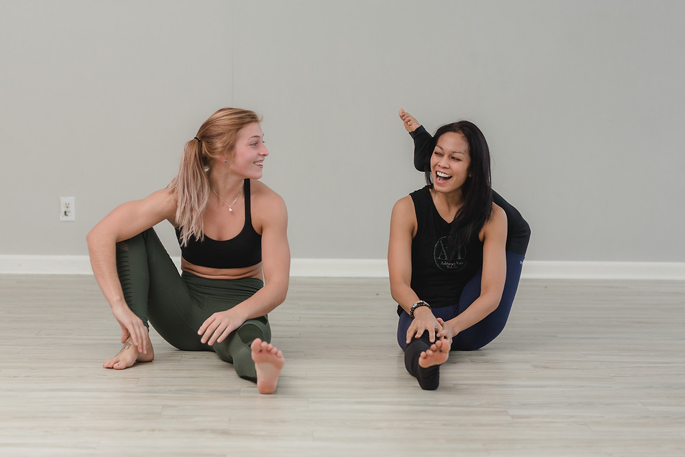 Hope Dalrymple and Dhawi Pienta laughing at Yogaja Yoga Toledo  Mary Wyar Photography