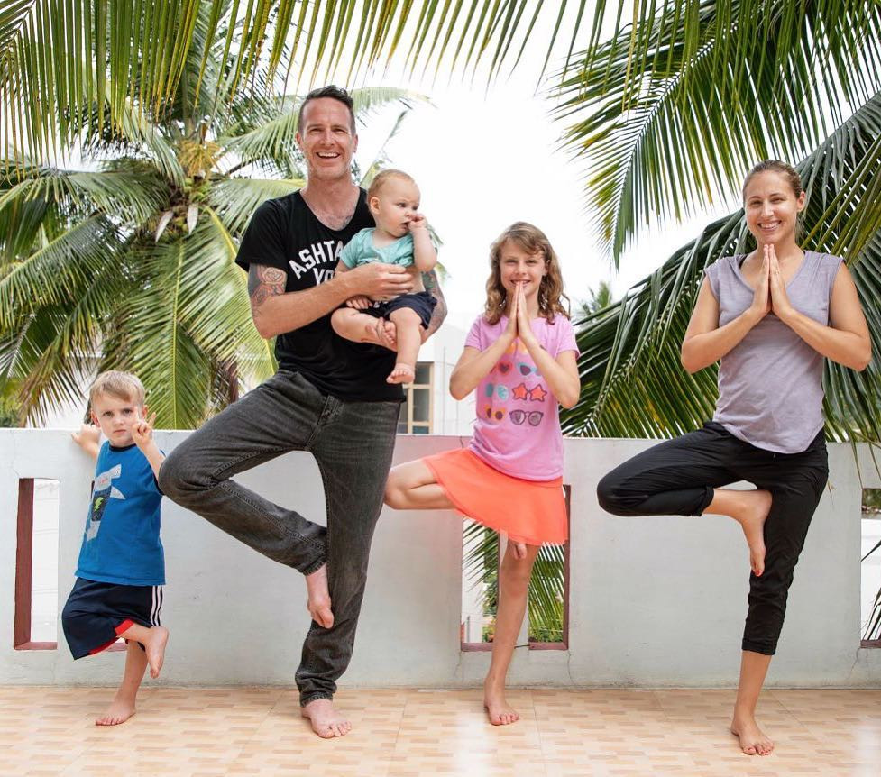 Taylor Hunt and family in Mysore, India standing in tree pose