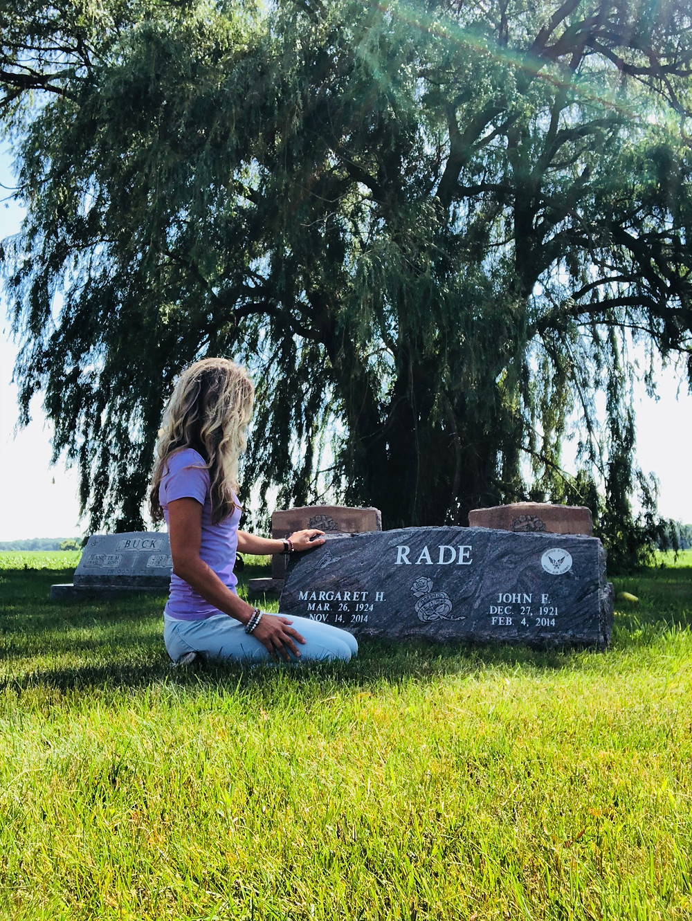 Shauna Gilsdorf visiting her grandparents at the cemetery