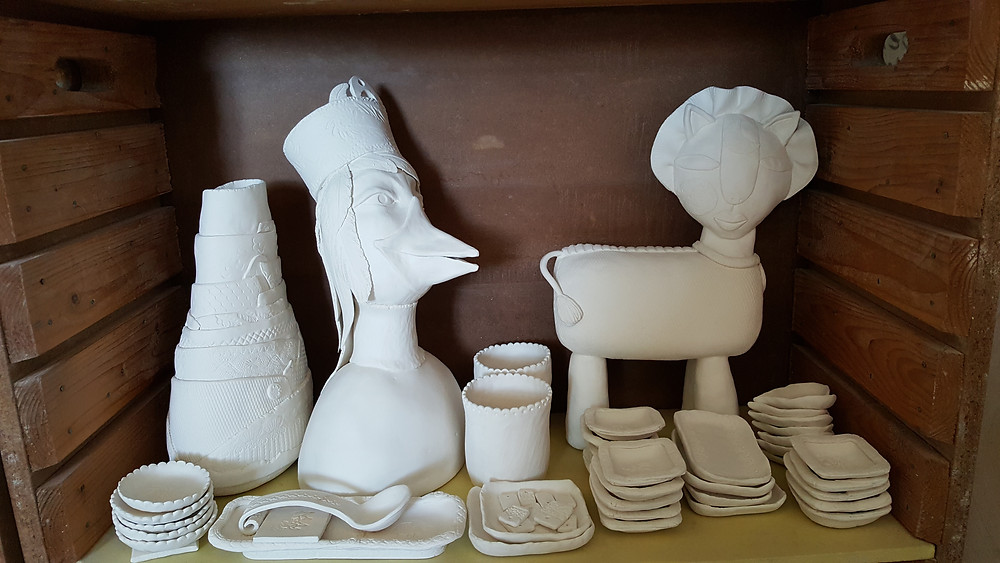 Bisqued sculptures and plates