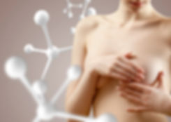 Young woman checks breasts for neoplasms