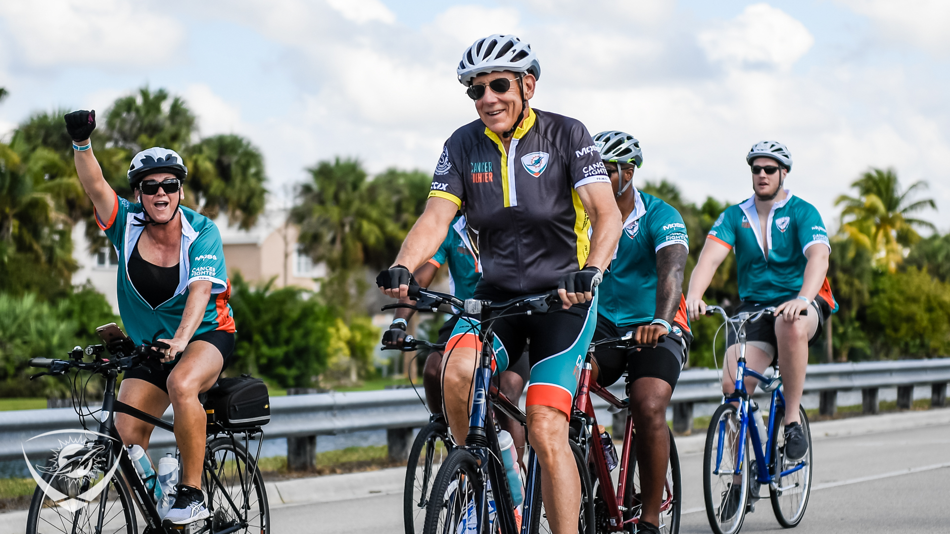 Dolphins Owner Stephen Ross rides in DCC