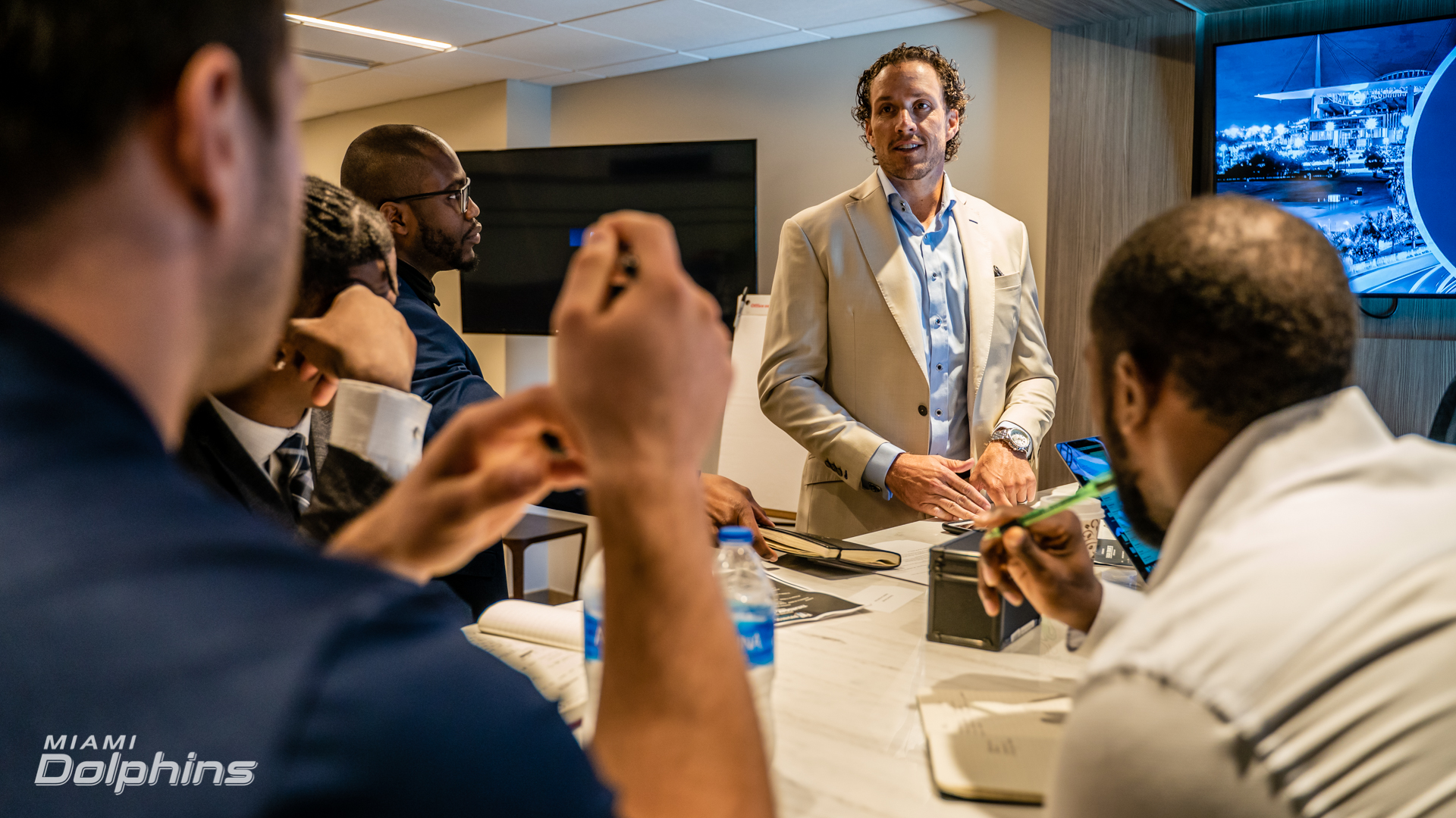 Dolphins Business Combine brainstorming.