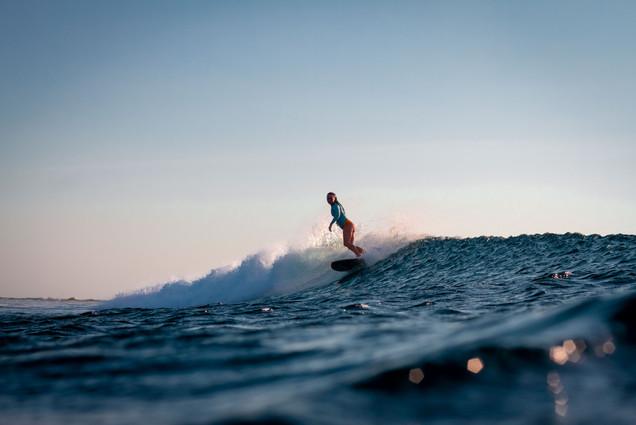 Indonesian sunset surfing