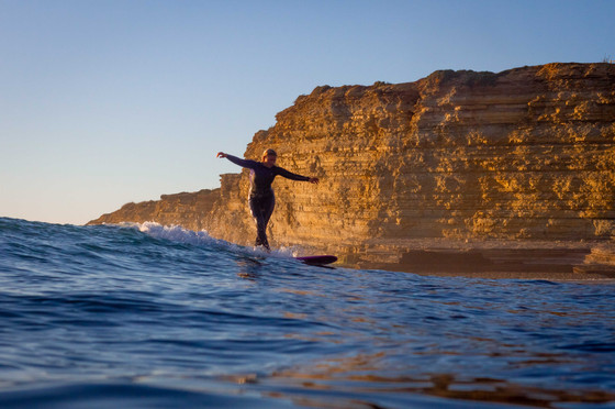 Sunset longboarder crossstep
