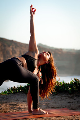 Triangle pose in sunset
