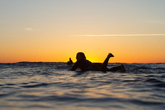 Longboarder in sunset