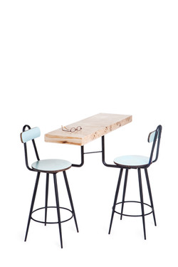 two chairs holding a table