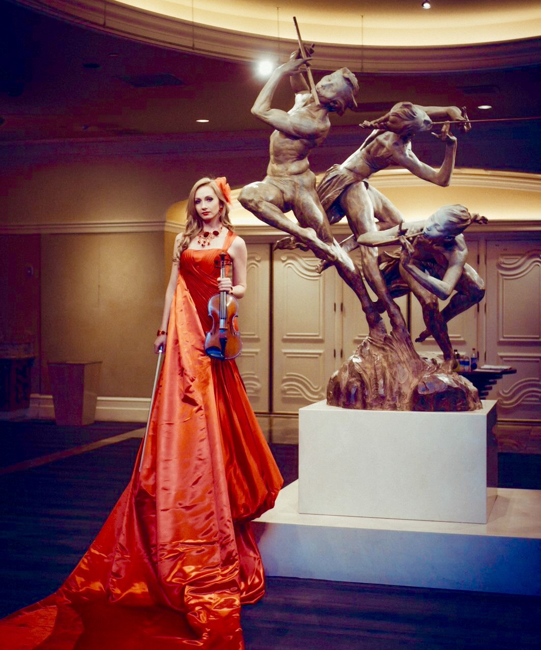 Aerial Artistry have created a unique experience for guests to walk on the red carpet before realising that it is part of a surreal, couture gown.