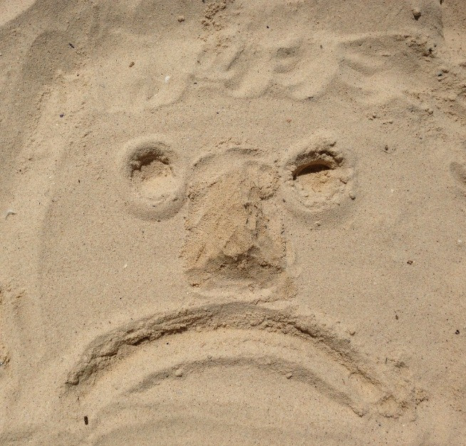 Sad face in sand.jpg