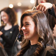 Photo-Female_Client_Smiles_During_Haircu